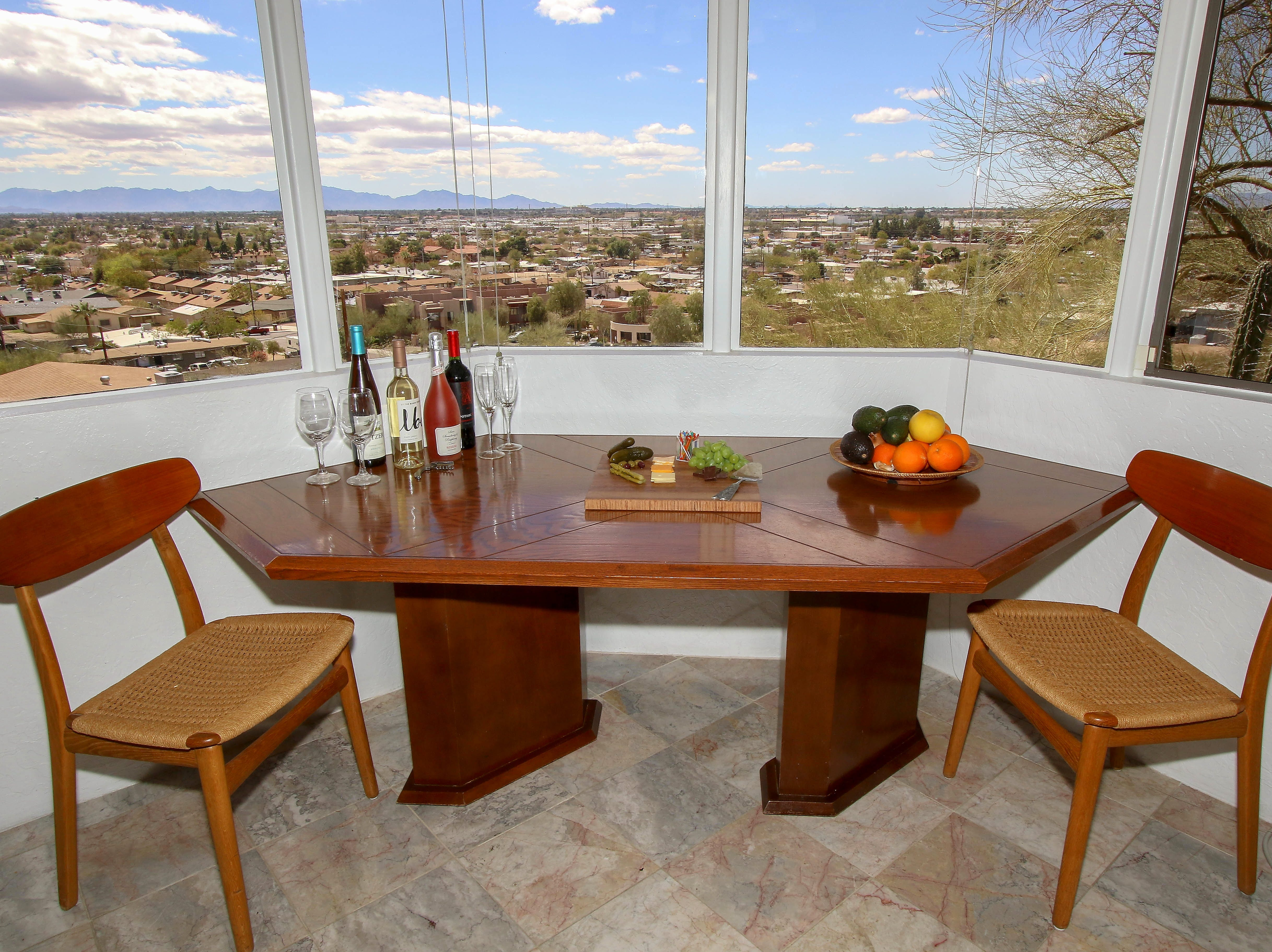The dining room table was custom built for the space, and can be pushed into the wall for buffet-style serving.