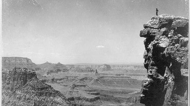 A lonely figure stands atop Sunset Point in the Grand Canyon, ca. 1899.