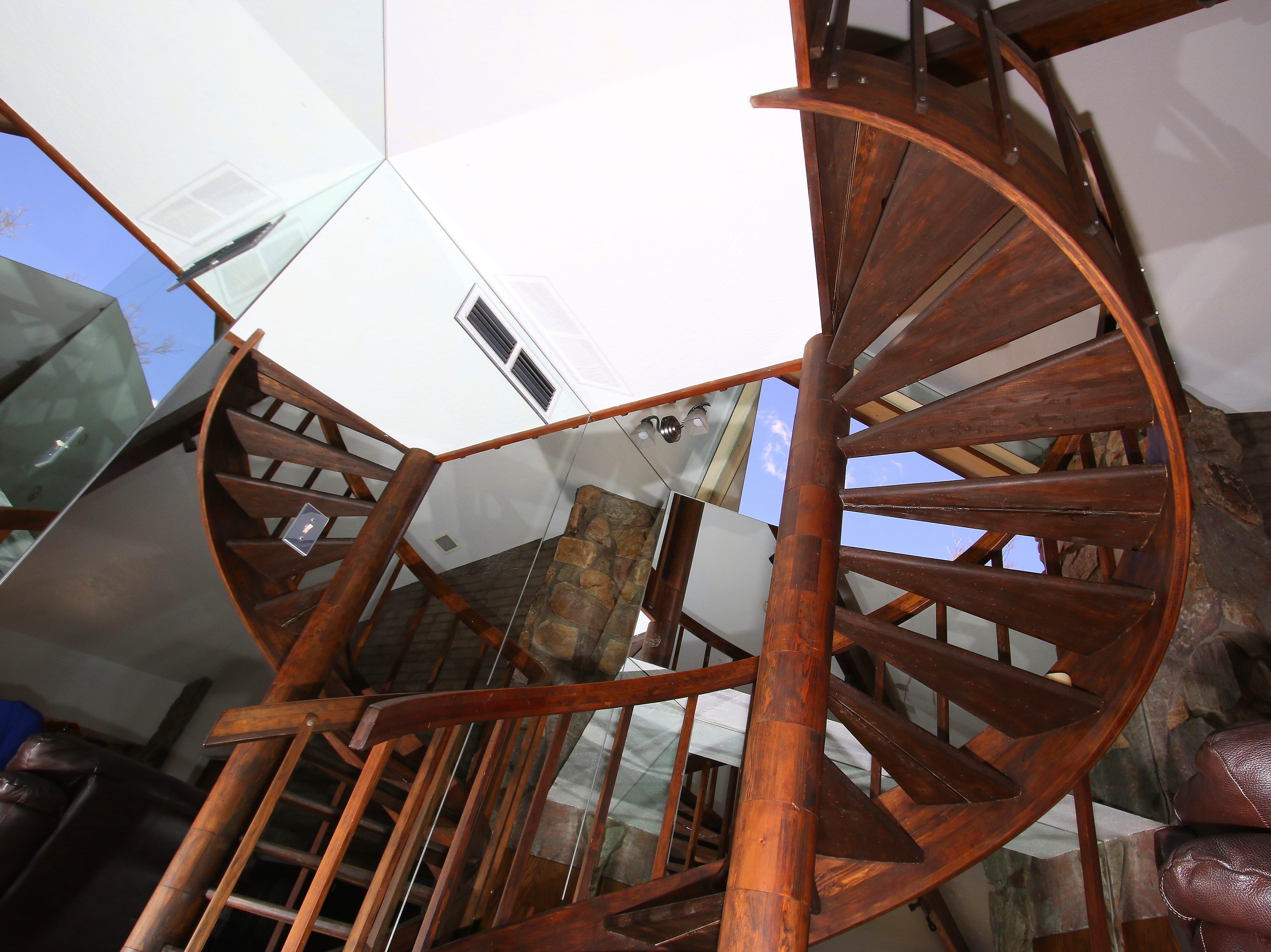 A view of the spiral staircase from below. The wood is purportedly from one single Hemlock tree in North Carolina.