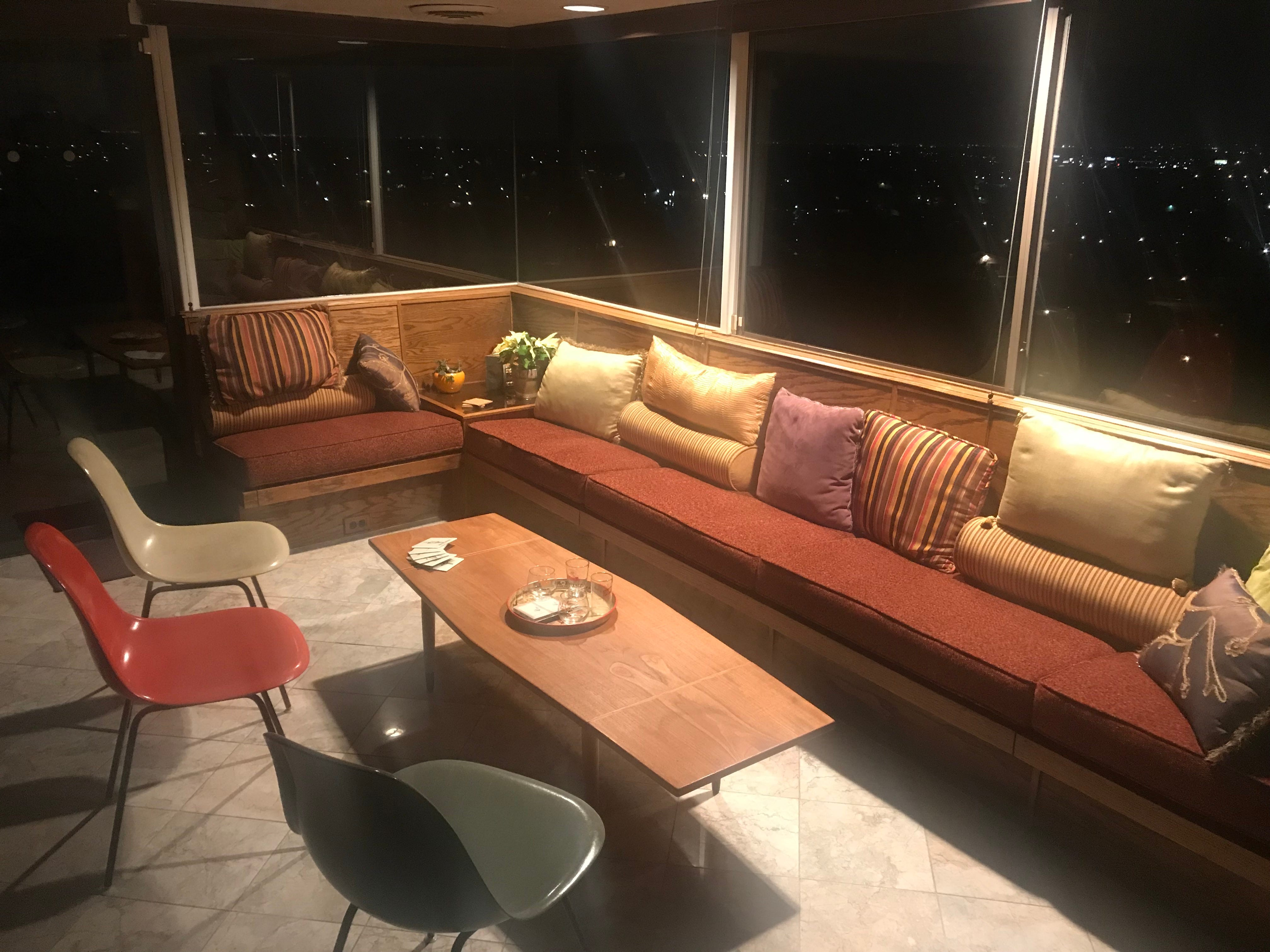 Yeager often designed built-in bench seating with functional storage. The seating in this case was placed to take advantage of 285-degree views of the Valley below. The Herman Miller chairs were a gift from Miller himself.