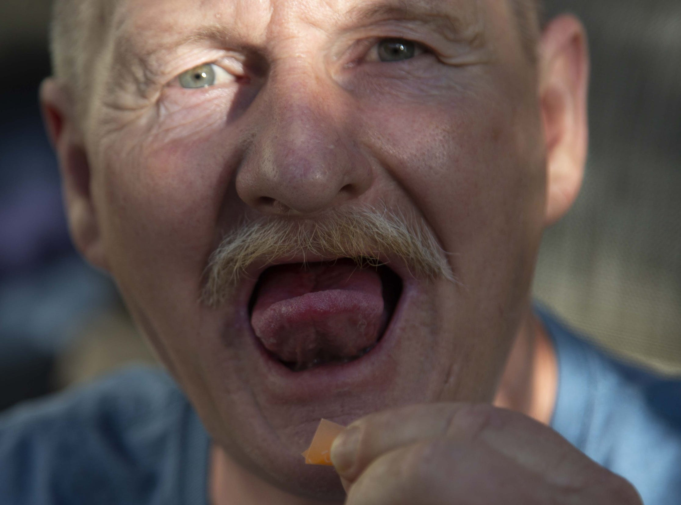 Lollice Reese, 54, takes his Suboxone before going to work. He said he is having success giving up heroin with medication-assisted treatment.