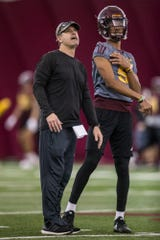 Offensive coordinator Rob Likens watches Jayden Daniels' pass during practice on Tuesday, Feb. 5, 2019, at the Verde Dickey Dome in Tempe, Ariz.