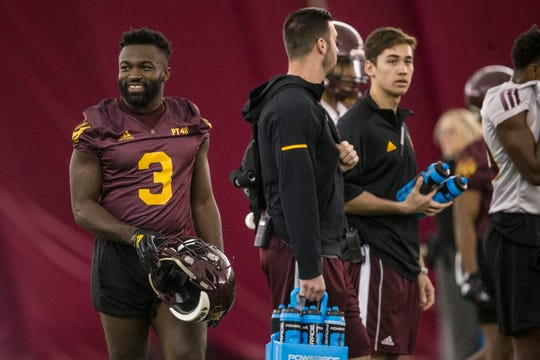 Eno Benjamin smiles between reps during practice on Tuesday, Feb. 5, 2019, at the Verde Dickey Dome in Tempe, Ariz.