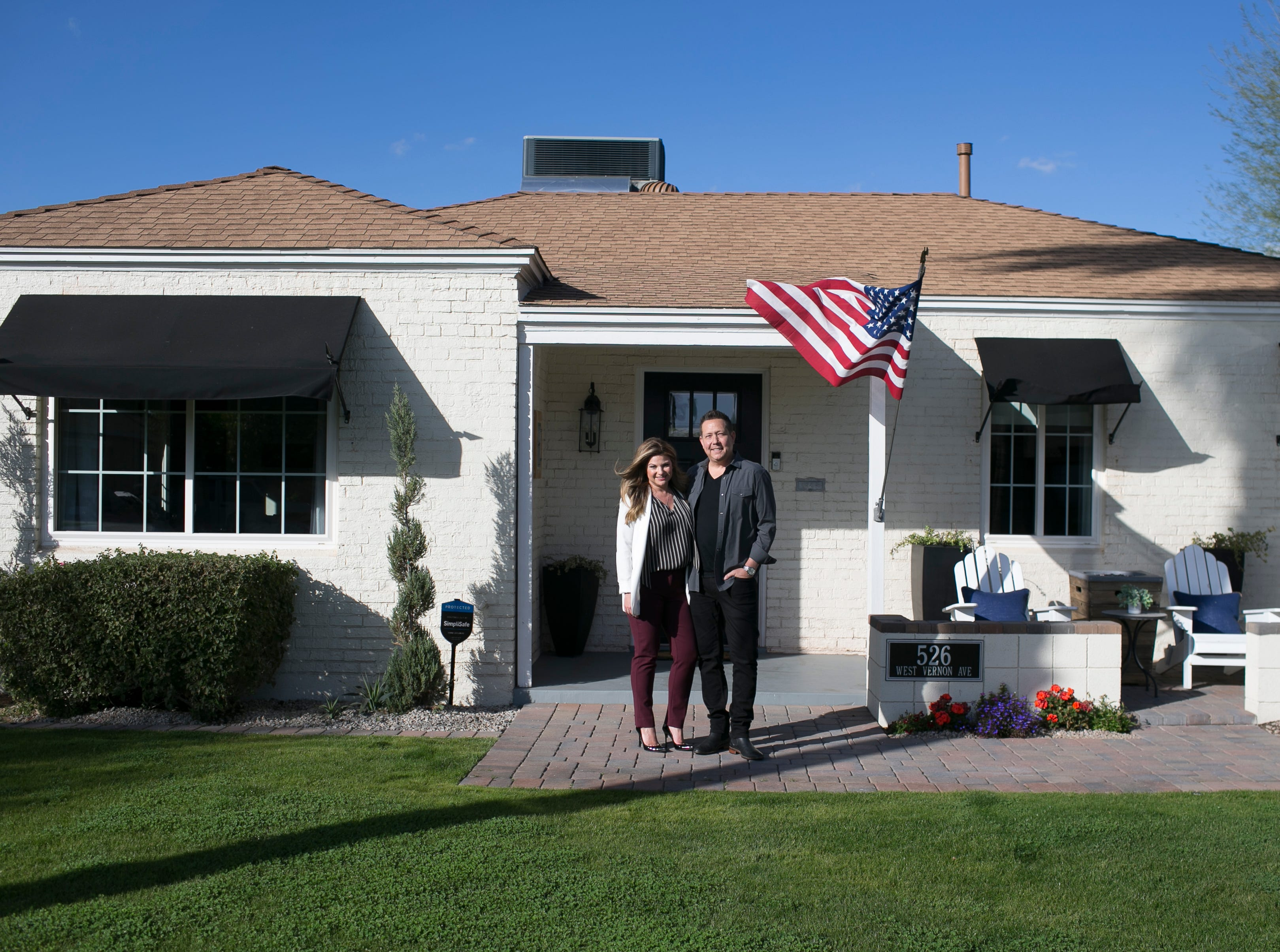 Kelly and Chris  Nottleman stand in front of their home Feb. 2, 2019, in Phoenix. The Nottlemans renovated their home and opened it to the public to be a part of the historic Willo district home tour.