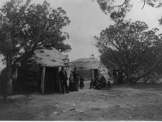 Navajos residing in hogans near the El Tovar Hotel, 1906.