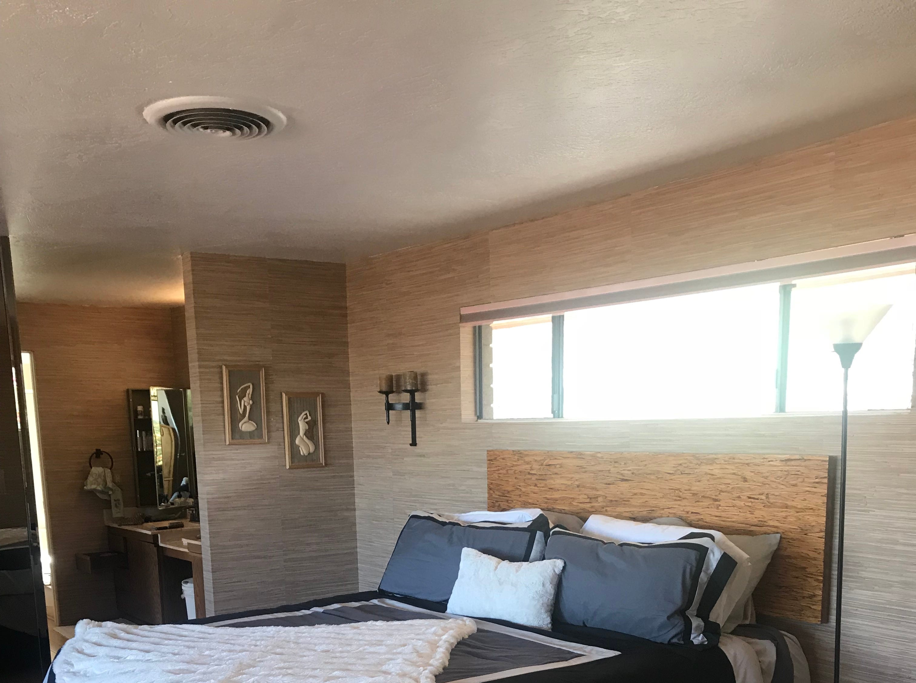 The master bedroom has views of the city below and the mountain behind it.