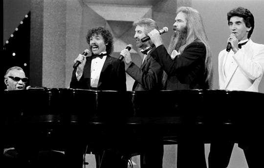 The Oak Ridge Boys were joined by Ray Charles at the piano during a 1984 appearance at the CMA Awards. Joe Bonsall (from left), Duane Allen, William Lee Golden and Richard Sterban form the Oaks.