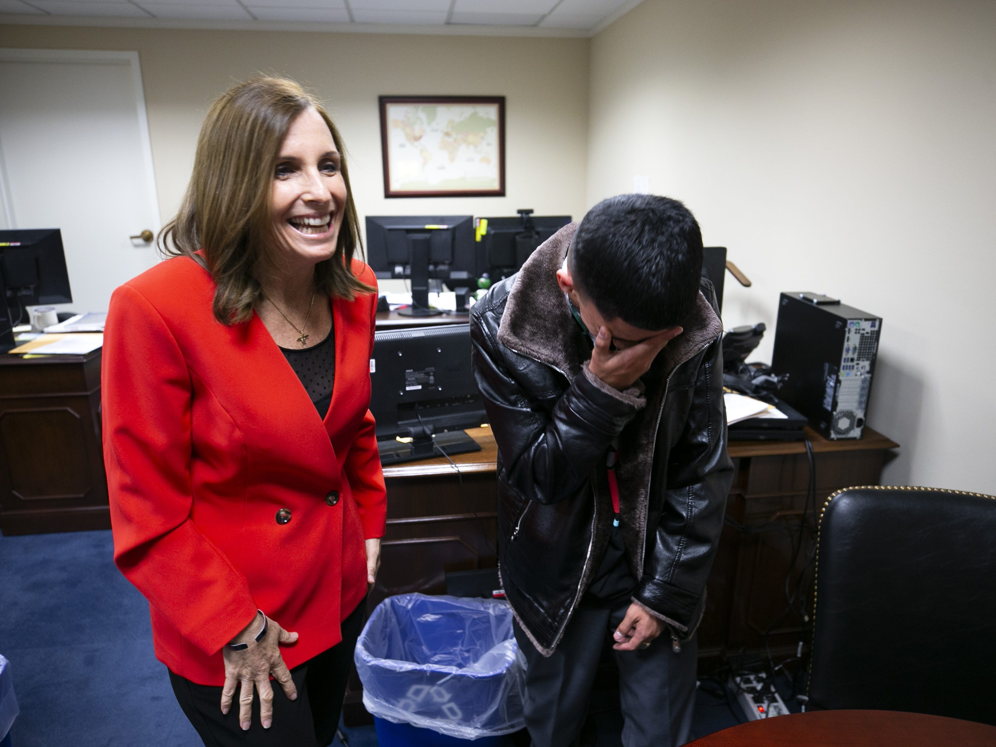 U.S. Sen. Martha McSally, R-Ariz., laughs with Isaiah Acosta, a 19-year-old rapper from Phoenix, at McSally's office at the Dirksen Senate Office Building in Washington, D.C., on Feb. 5, 2019. Acosta will be McSally's guest at the State of the Union.