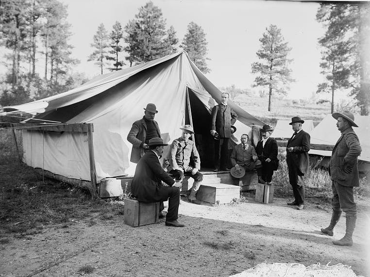 Travelers gather outside a hotel tent erected along the Grand Canyon Stage Road, ca. early 1900s.