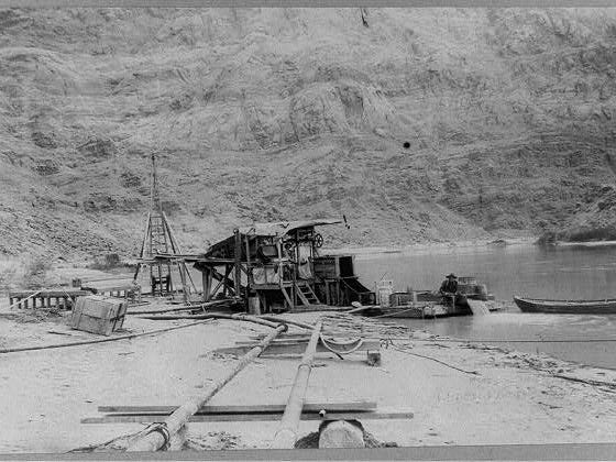 A placer mine operates in 1913 at Lees Ferry, where Mormon pioneers often crossed the Colorado River. The river was nearly impossible to cross once it entered the Grand Canyon.