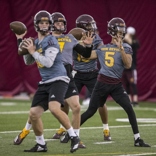 Left to right: Joey Yellen, Ethan Long, Dillon Sterling-Cole, and Jayden Daniels throw during a passing drill during practice on Tuesday, Feb. 5, 2019, at the Verde Dickey Dome in Tempe, Ariz.