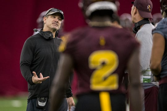 Offensive coordinator Rob Likens talks to players during practice on Tuesday, Feb. 5, 2019, at the Verde Dickey Dome in Tempe, Ariz.