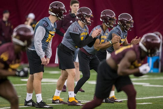 Left to right: Joey Yellen, Ethan Long, Jayden Daniels, and Dillon Sterling-Cole line up for a passing drill during practice on Tuesday, Feb. 5, 2019, at the Verde Dickey Dome in Tempe, Ariz.