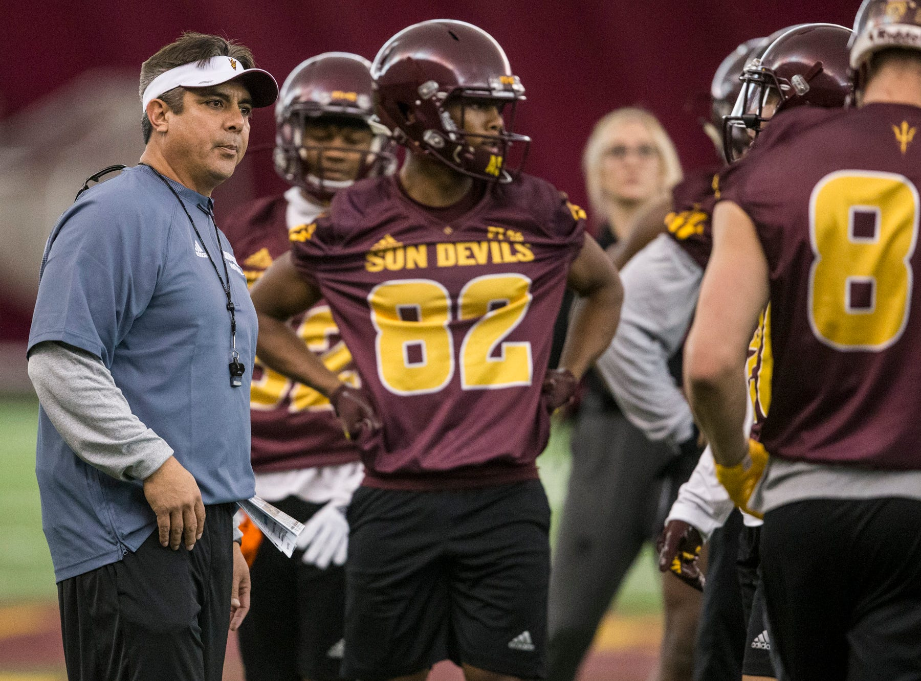 Running backs coach Shawn Aguano gives instructions during practice on Tuesday, Feb. 5, 2019, at the Verde Dickey Dome in Tempe, Ariz.