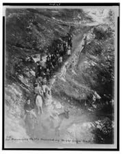 Teddy Roosevelt leads a party descending into the Grand Canyon, 1911. Roosevelt was instrumental in the preservation of the canyon.