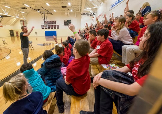 A group of students from different schools attend a pep rally held inside Cardinal Mooney Catholic High School's gymnasium Tuesday, Feb. 5, 2019 as part of the school's Catholic Schools Week celebration.