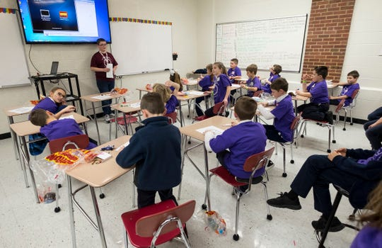 Donald Pomaville, a Cardinal Mooney Catholic High School freshman, leads a group of younger students from different schools in a retreat session Tuesday, Feb. 5, 2019 during the school's Catholic Schools Week celebration.
