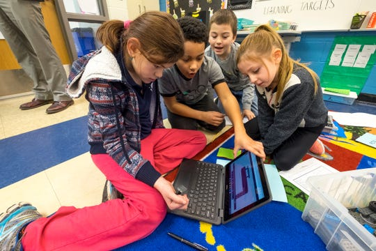 STEAM Academy at Woodrow Wilson third-graders Alivia Allen, left; Parrison Rome, left of center; Izzayuh Pulliam, right of center, and Desirae Taylor watch instructions in a 3D modeling program on a district-provided Chromebook Tuesday, Feb. 5, 2019 in the STEAM portion of their class. The class is using their knowledge of simple machines to design and build more complex ones.