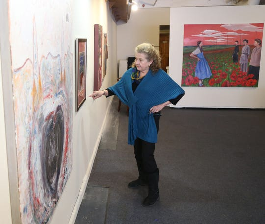 Nansi Lent talks about one of her paintings at the Queen City 15 Art Gallery in the City of Poughkeepsie on February 1, 2019.