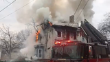 Tyrone Cheatham, whose family owns the building, and Calvin Thompson, a second-floor resident, discuss the Tuesday morning fire on Winnikee Avenue.