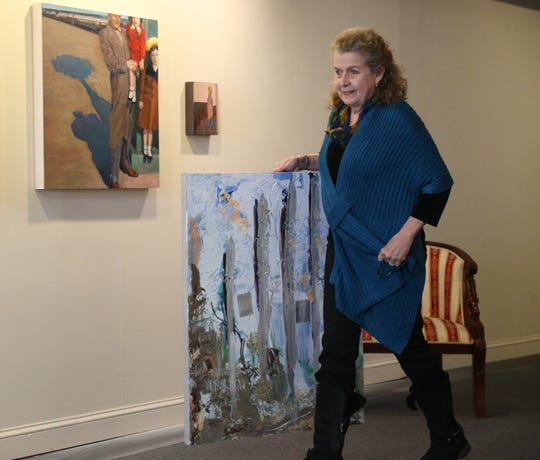 Nansi Lent with one of her paintings at the Queen City 15 Art Gallery in the City of Poughkeepsie on February 1, 2019.