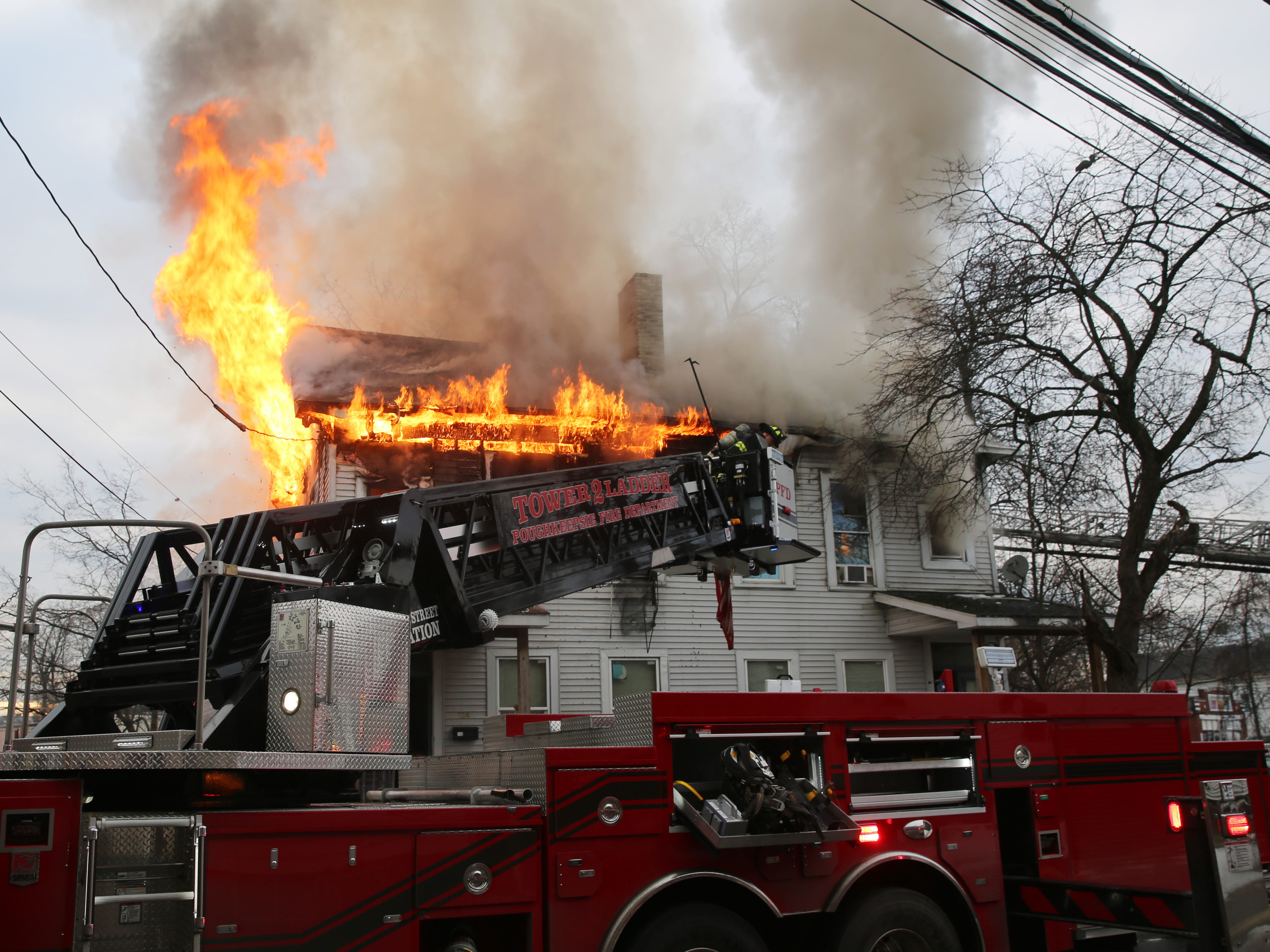 Poughkeepsie Fire Department Tower Ladder 2 is brought into service at a fire on Winnikee Avenue in the City of Poughkeepsie on Feb. 5, 2019.