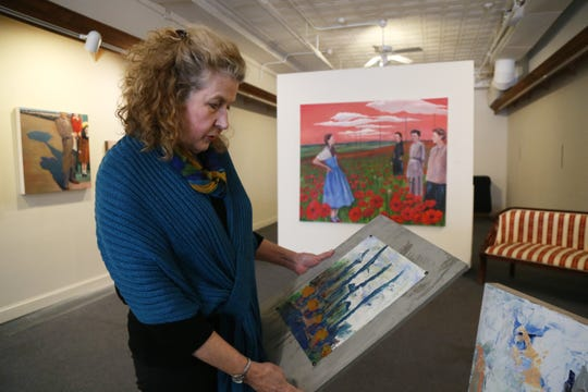 Nansi Lent looks over one of her paintings at the Queen City 15 Art Gallery in the City of Poughkeepsie on February 1, 2019.