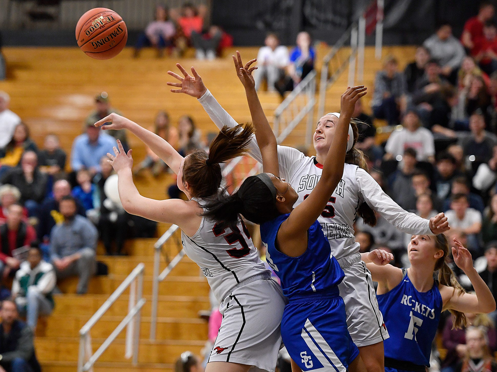 Spring Grove's Hylin Sorrell, center, battles for a rebound with Maddy McMaster (34) and Taylor Geiman (35) of South Western, Monday, Feb. 4, 2019.John A. Pavoncello photo
