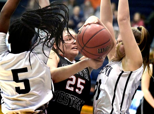 South Western's Ali St. Rose is sandwiched between Dallastown's D'Shantae Edwards, left, and Madi Moore during action at Dallastown on  Tuesday, Jan. 22 St. Rose helped the Mustangs to a 15-5 regular season and the No. 2 seed from Division I for the York-Adams League playoffs.
