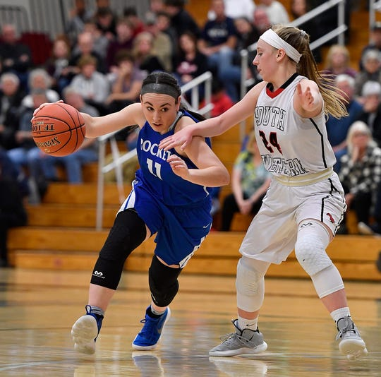 Spring Grove's Haley Wagman drives past Madi Wisensale of South Western, Monday, Feb. 4, 2019.