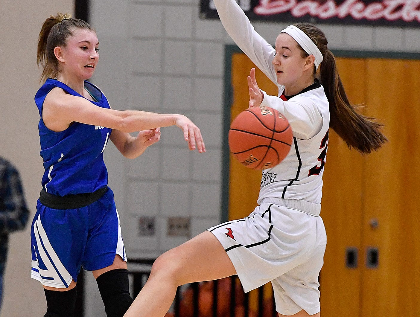 Spring Grove's Addyson Wagman makes a leaping pass around Taylor Geiman of South Western, Monday, Feb. 4, 2019.John A. Pavoncello photo
