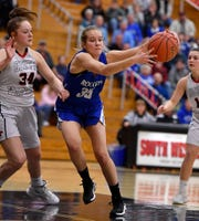 Spring Grove's Brooklyn Naylor, right, reaches for the ball as she loses control while covered by Maddy McMaster of South Western, Monday, Feb. 4, 2019.