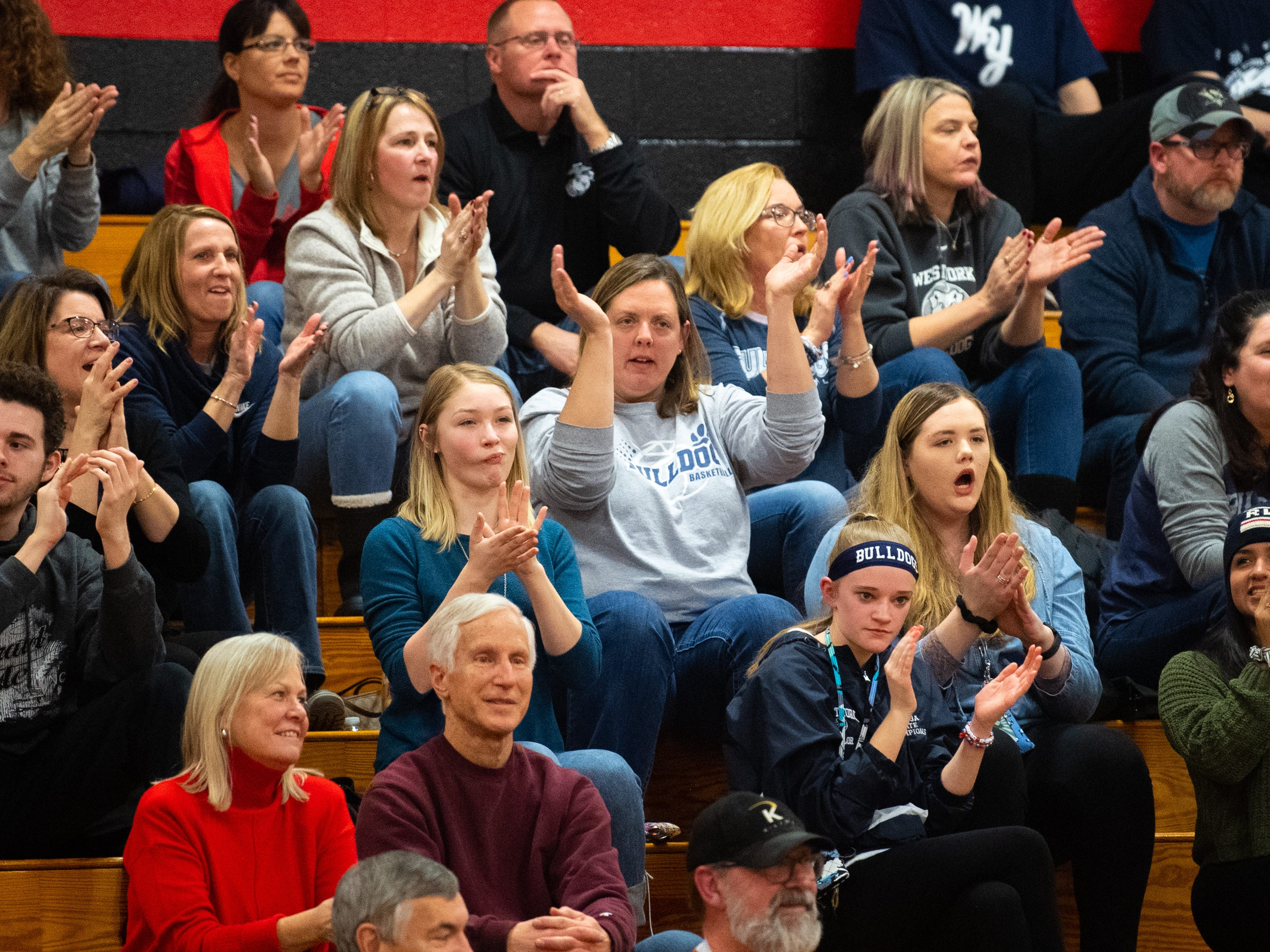 West York fans cheer on their team during the boys' basketball game between Dover and West York, February 1, 2019 at Dover Area High School. The Eagles defeated the Bulldogs 65 to 58.