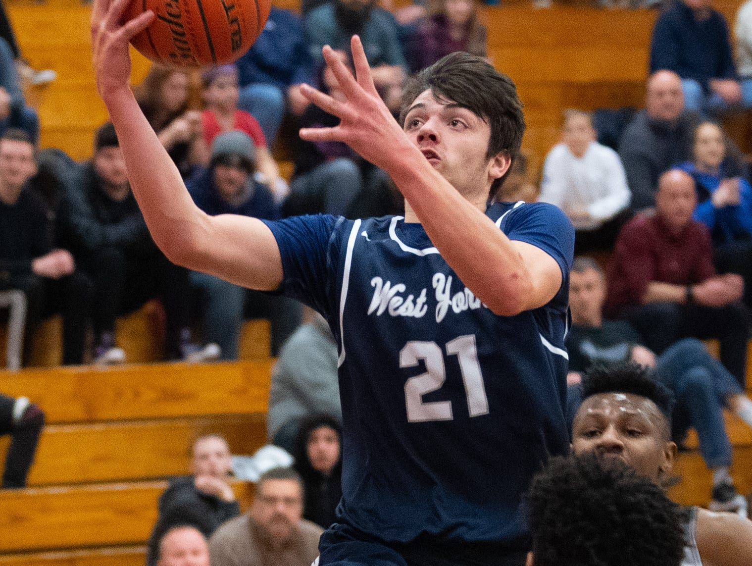 Jared Shearer (21) glides to the basket during the boys' basketball game between Dover and West York, February 1, 2019. The Eagles defeated the Bulldogs 65 to 58.