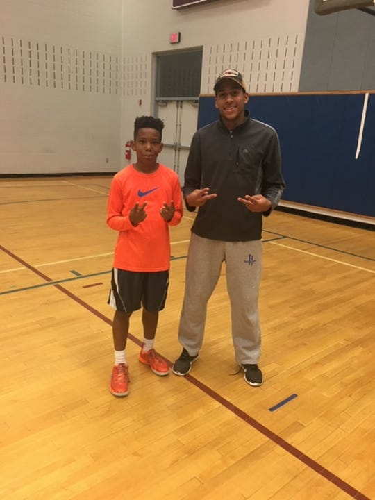 Jalen Franklin poses with former Spring Grove superstar Eli Brooks when he was a middle school student in the Spring Grove School District.