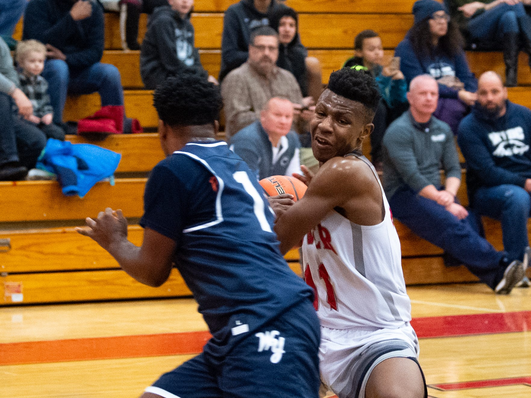 Victor Dorm tries to protect the ball during the boys' basketball game between Dover and West York, February 1, 2019. The Eagles defeated the Bulldogs 65 to 58.