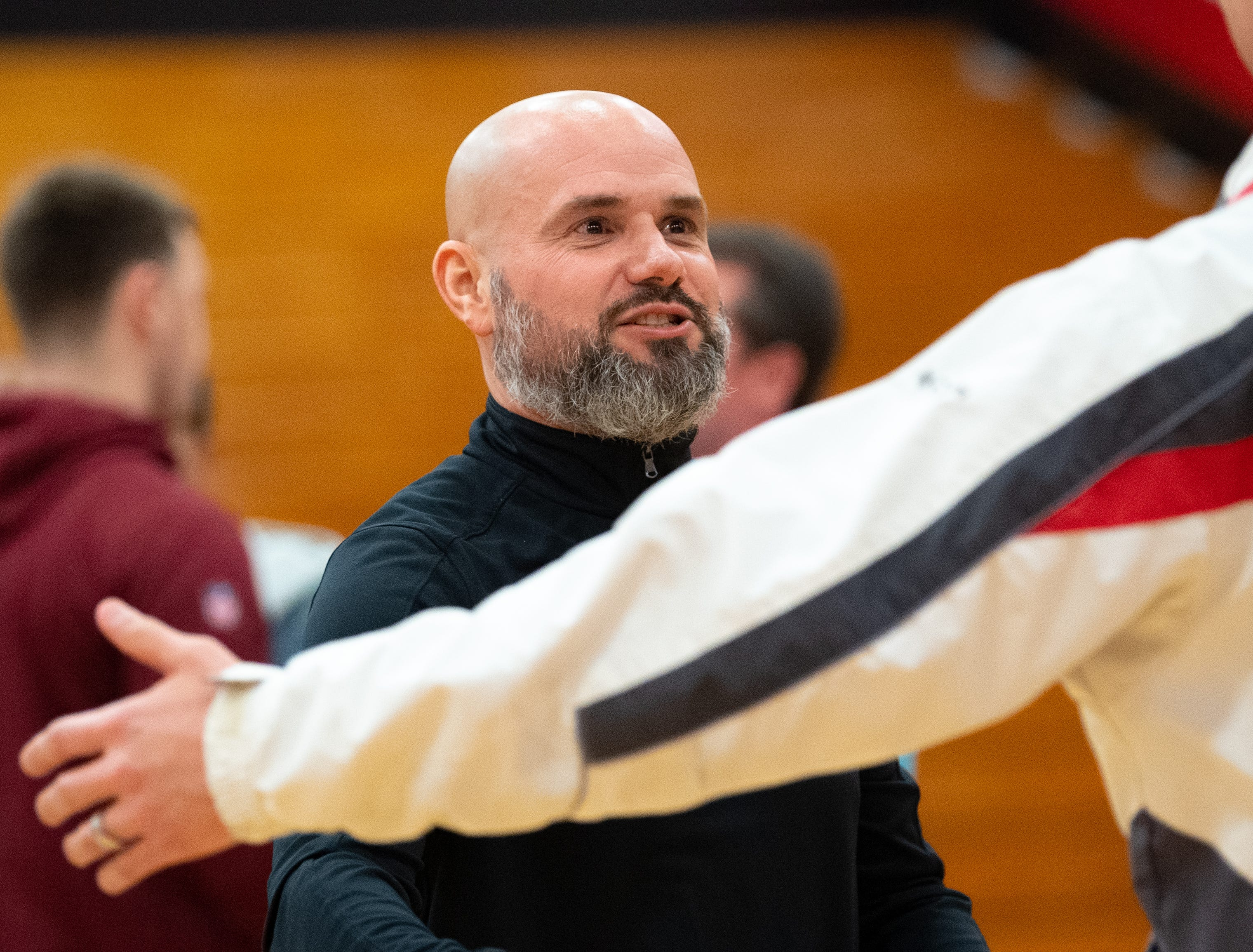 Dover head coach Brian Schmoyer goes to hug all of the players he coached over the years, February 1, 2019.