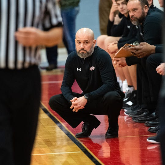 Dover head coach Brian Schmoyer watches as the refs discuss a call during the boys' basketball game between Dover and West York, February 1, 2019. The Eagles defeated the Bulldogs 65 to 58.