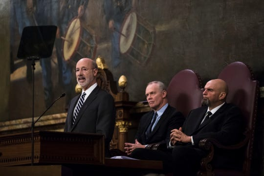 Democratic Gov. Tom Wolf, left, delivers his budget address for the 2019-20 fiscal year to a joint session of the Pennsylvania House and Senate in Harrisburg, Pa., Tuesday, Feb. 5, 2019. House Speaker Mike Turzai, R-Allegheny, is at the center, and Lt. Gov. John Fetterman is at the right. (AP Photo/Matt Rourke)