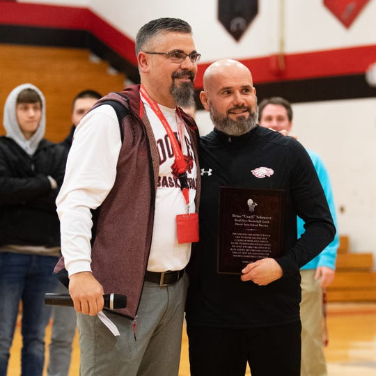After a hard fought victory at home, Dover head coach Brian Schmoyer was honored and thanked for all he's done for the Dover basketball program. Dover Athletic Director Rich Leathery presented Schmoyer a plaque, February 1, 2019.