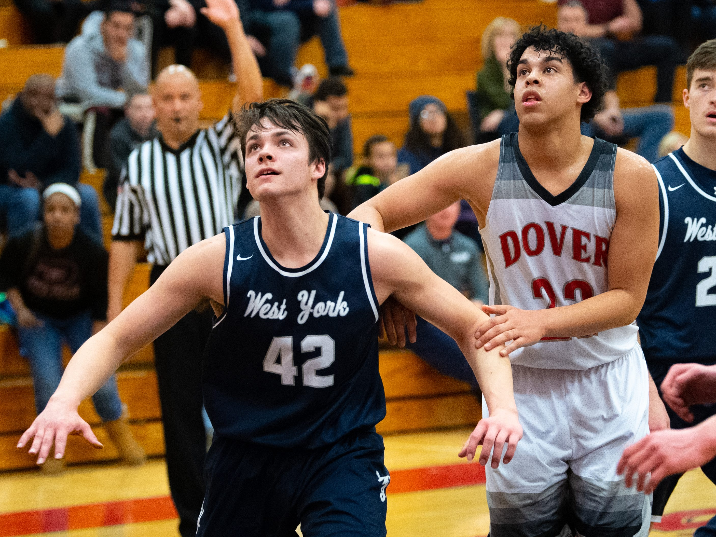 Gabe Mummert (42) of West York looks to grab the rebound during the boys' basketball game between Dover and West York, February 1, 2019. The Eagles defeated the Bulldogs 65 to 58.