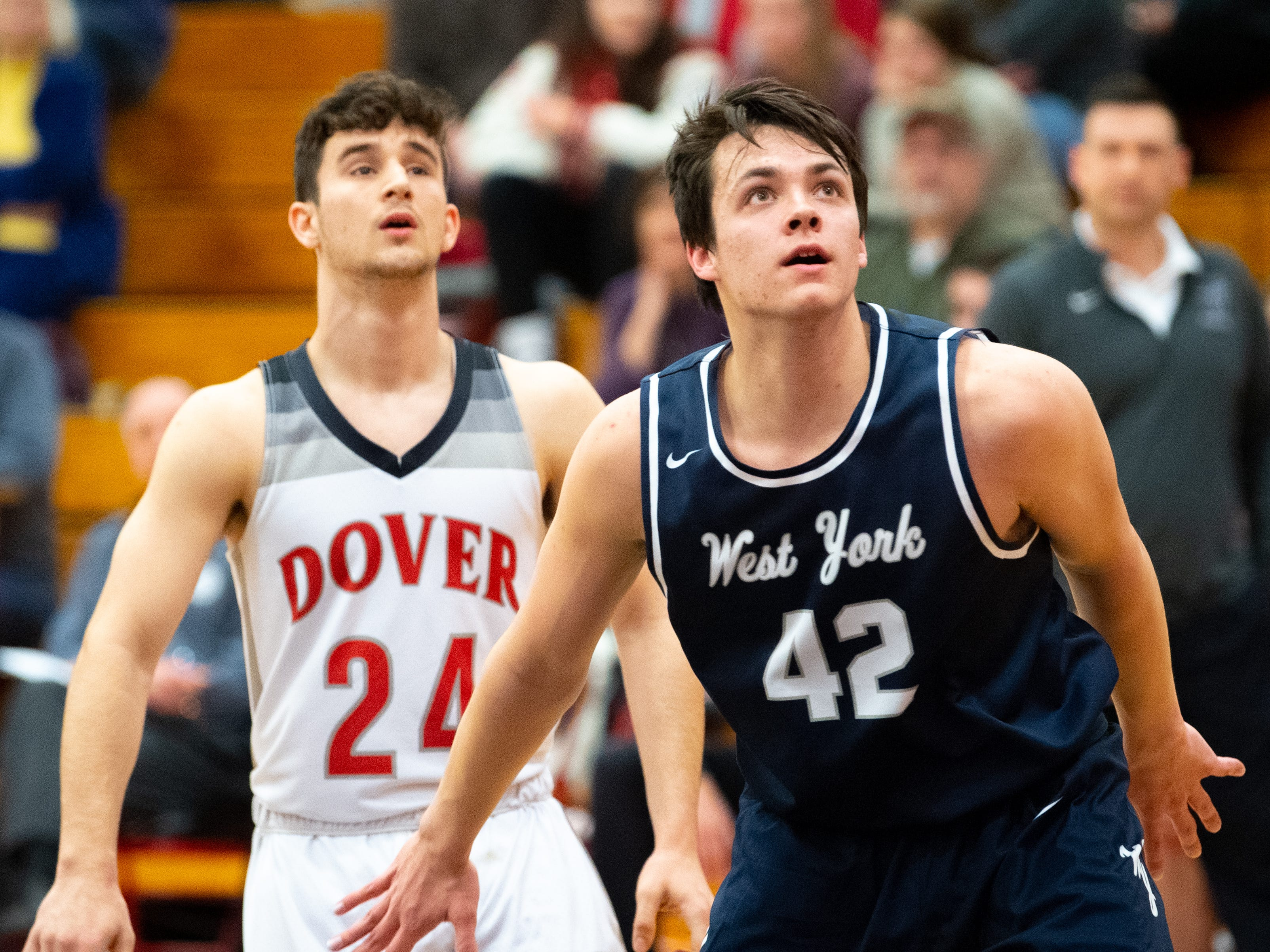 Gabe Mummert (42) boxes out Adam Jovicevic (24) during the boys' basketball game between Dover and West York, February 1, 2019 at Dover Area High School. The Eagles defeated the Bulldogs 65 to 58.
