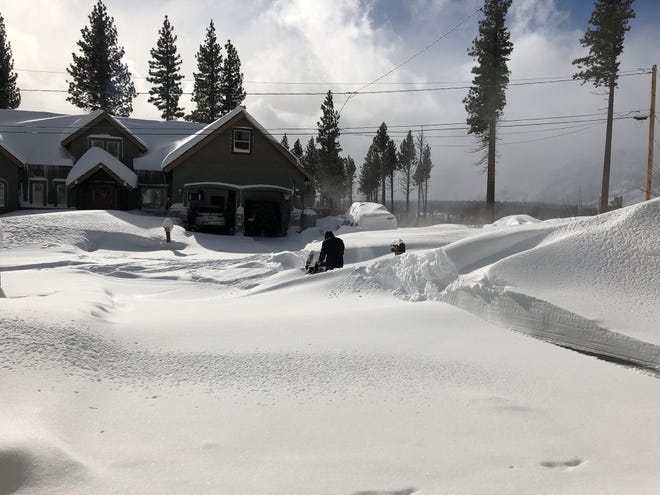 A resident of South Lake Tahoe clears snow on Feb. 5, 2019.