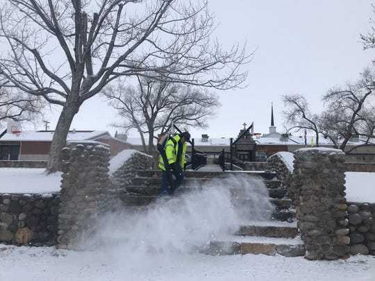 A man blows snow off steps at Plumas Park in Reno on Feb. 5, 2019.