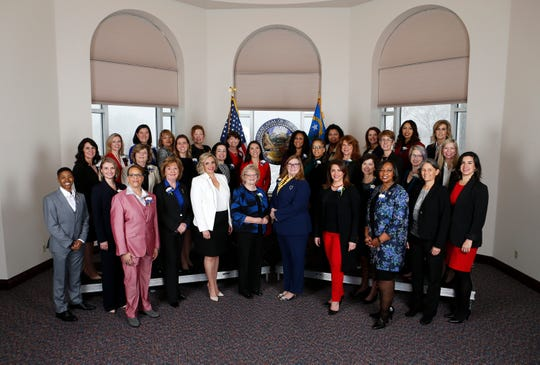 Thirty-two female members of the Nevada Legislature pose for photos before the start of the 80th Legislative Session, in Carson City, Nev., on Monday, Feb. 4, 2019. The group represents the first female majority Legislature in the country.