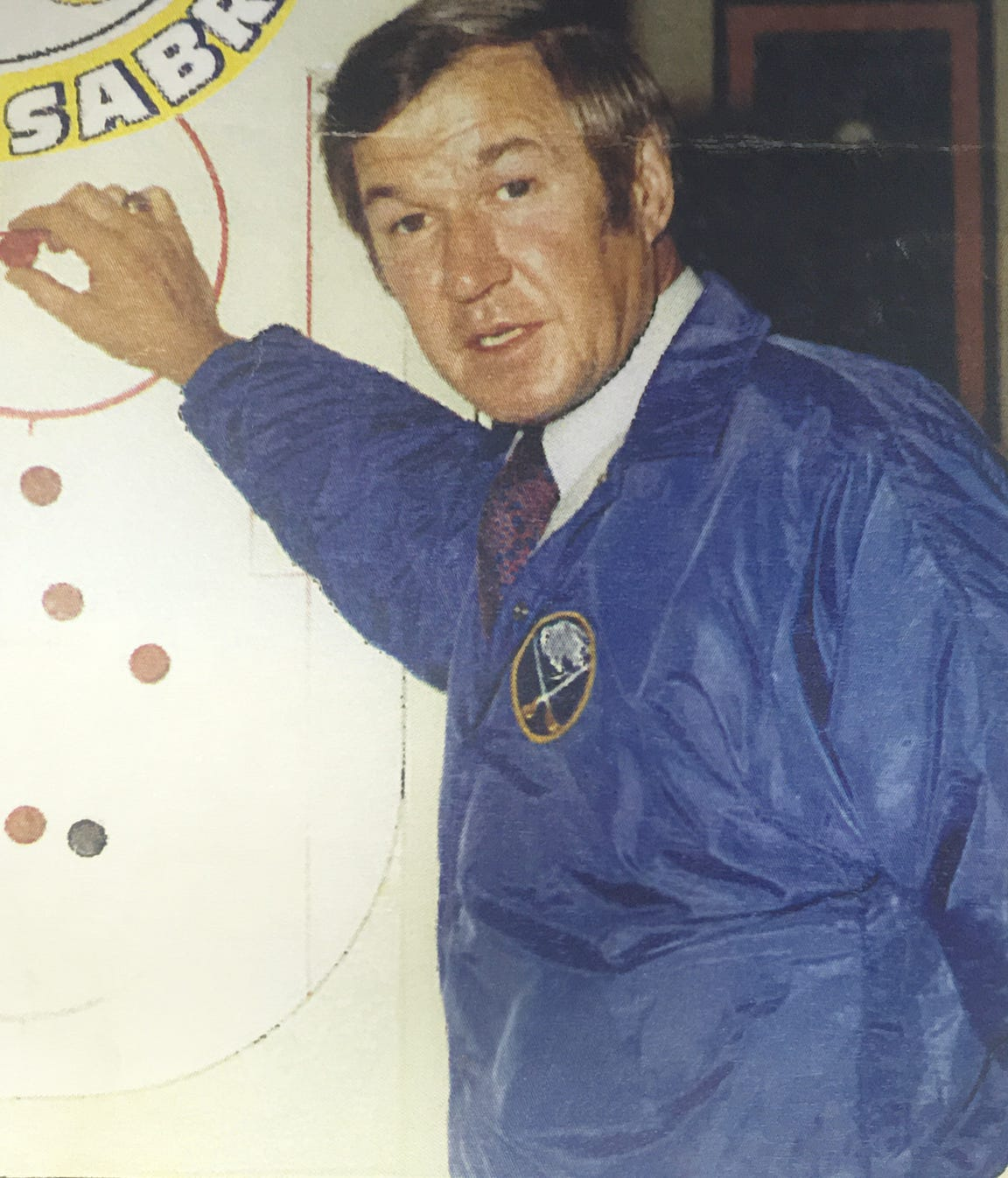 Joe Crozier played a key role in putting Buffalo on the NHL map when he took the Sabres to their first playoff berth in 1972-73, just the franchise's third year of existence. His hockey partner through life, Punch Imlach, had suffered a heart attack the previous year and had to step down, giving Crozier his NHL break.