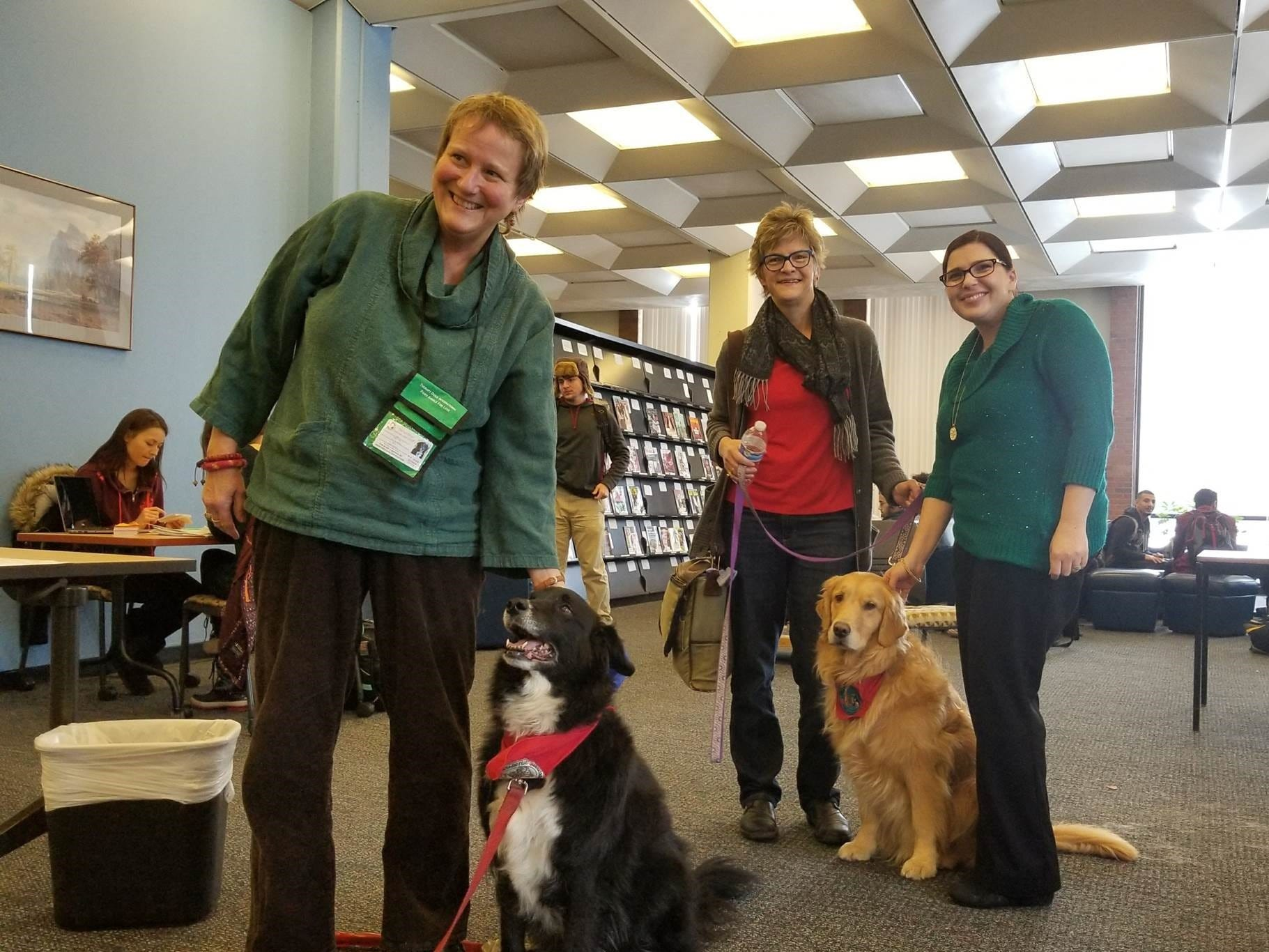 At left, Ann Tippett, a professor at Monroe Community College stands with her certified therapy dog, Milli. At center, Kathleen O'Shea, also a professor at MCC, stands with her certified therapy dog, Gretta. The dogs make trips to places like the library at MCC to spend time with students and help provide comfort and alleviate stress.