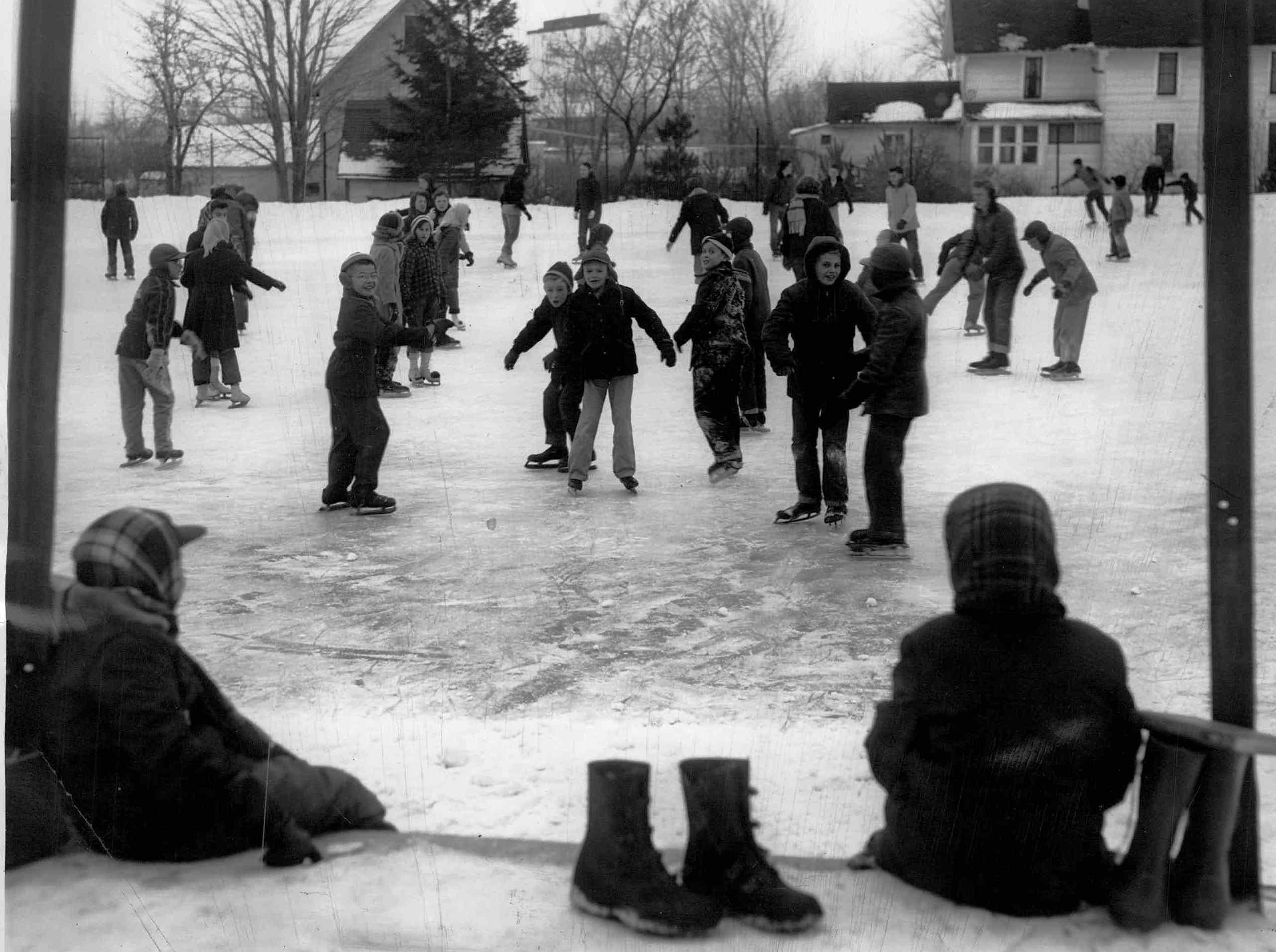 In this photo from 1956, skaters make their way around an ice rink made for community use by West Webster firemen.