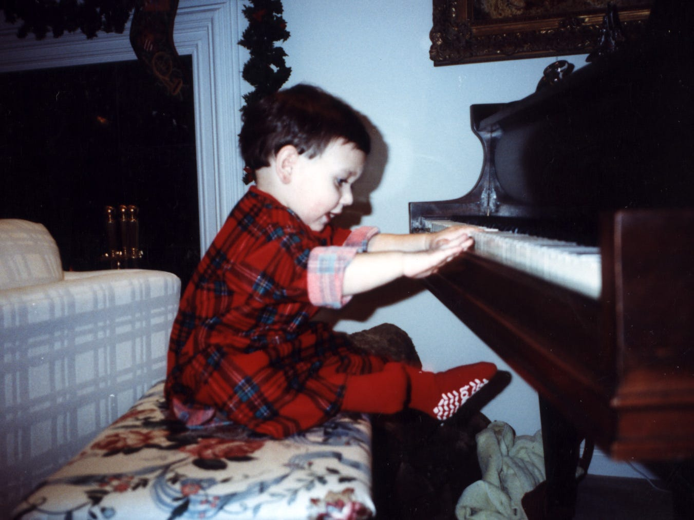 Teddy Geiger 'playing' the piano at a tender age.