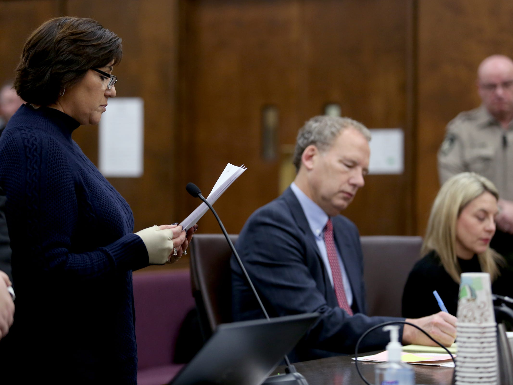Annmarie Ruiz reads a statement from Peggy Holland as Jennifer Weathers enters a guilty plea for driving under the influence on the night of her daughter's death in 2018 at the Yamhill County Courthouse in McMinnville on Tuesday, Feb. 5, 2019. Meighan Cordie died from blunt force trauma after jumping or falling out of the car her mother was driving while her 3-year-old daughter was also in the vehicle.